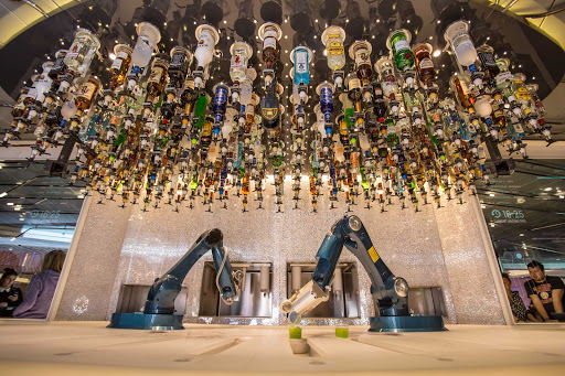 Like its sister ships, Symphony of the Seas features a Bionic Bar where robots will mix your drinks.