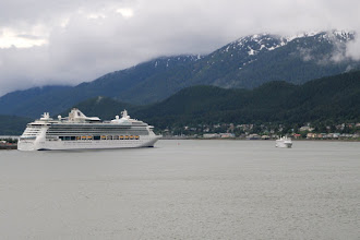 Photo: Large cruise ship (on left) and our ship, the Spirit of Endeavour (on right), sailing into Juneau