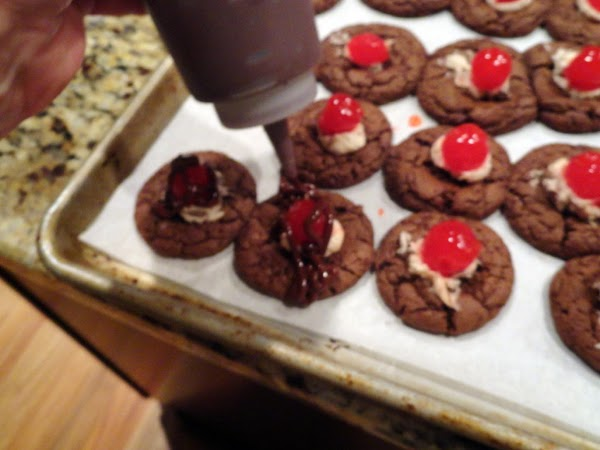 Melt the remaining milk chocolate chips and drizzle over the cookies.  NOTE: The...