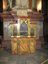 Photo: This small organ near the altar is probably used to accompany singing.