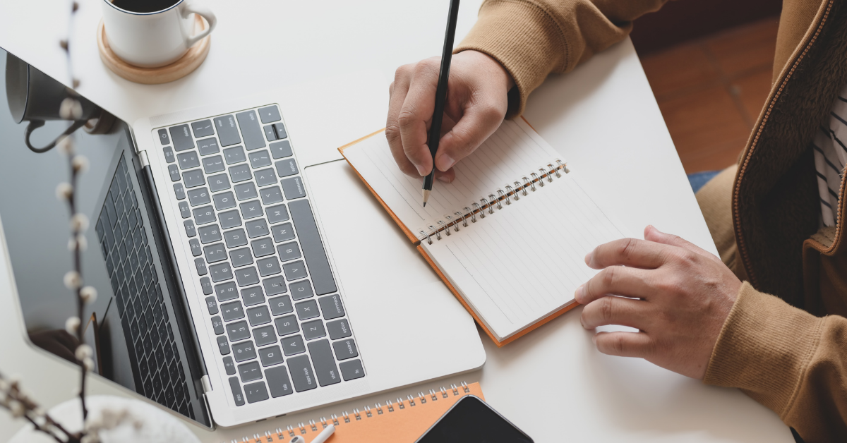 taking notes to prepare for a sales call
