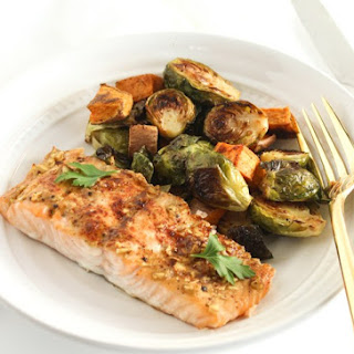 Sheet Pan Maple Dijon Salmon With Brussels Sprouts and Sweet Potatoes.