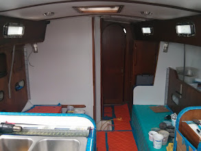 Photo: looking forward from companionway after painting bulkheads and re-installing chainplates