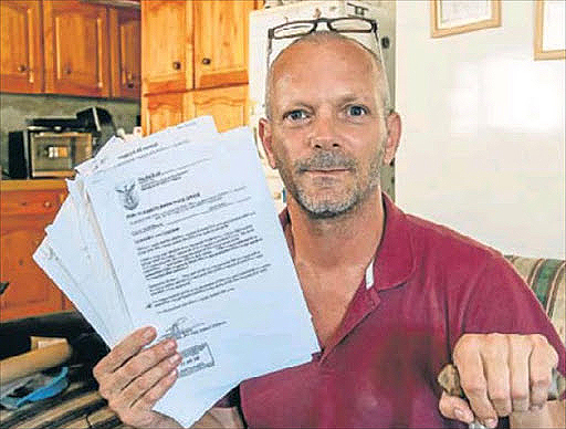 Maurice Pirzenthal with police documents detailing his mother's alleged misbehaviour. File photo.