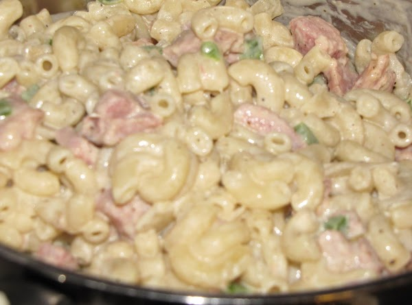 Add the sour cream and ham mixture to the macaroni and mix well. Season...