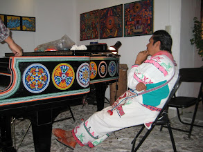 Photo: This artist was turning a piano into a beaded sculpture.