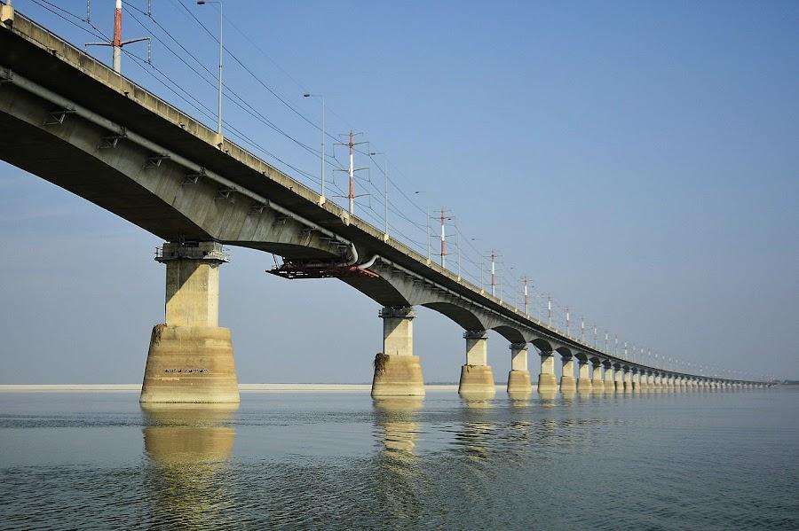 Bridge Tie.. by Sofia Zaman - Landscapes Waterscapes ( natural light, sky, nature, bridge, poles, river )
