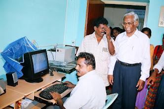 Photo: Mr.Sudarshan switches on the computers at our CTC