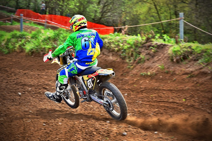 Full Acceleration by Marco Bertamé - Sports & Fitness Motorsports ( bike, motocross, blue, green, dust, motorcycle, clumps, alone, race, accelerating, competition )