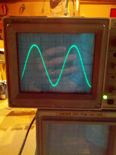 Photo: Output on 80m!  The trace isn't calibrated (it's using a simple capacitive pickup in a bud box from radio shack), but the key is that the waveform is clean.  The spectrum analyzer (under the scope) showed no harmonics, and the scope shows no AF noise on the carrier.  Score!