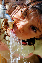 Photo: An Iraqi girl drinks water from a faucet at a camp for around 75 displaced Shiite families in the Sadiyah neighborhood of Baghdad, Iraq on Thursday, Sept. 27, 2007. (AP Photo/Wisam Sami)