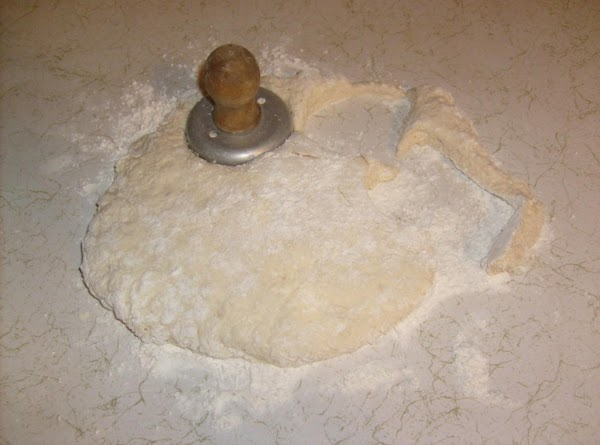 "Place dough onto a floured countertop or other flat surface. Pat to 2"" thick..."