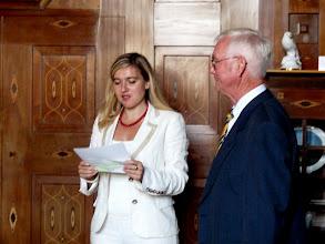 Photo: Als vorletzter bin ich an der Reihe. Frau Staatsekretärin Melanie Huml verliest die Begründung für die Ordensverleihung.