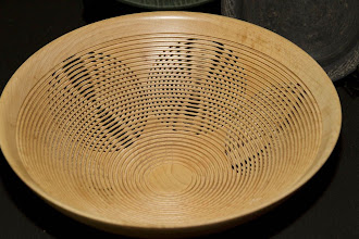 Photo: This very complex doubly beaded bowl on multiple axes is in the vein of the work of Hans Weissflog. I'd like to learn how to do that some day...