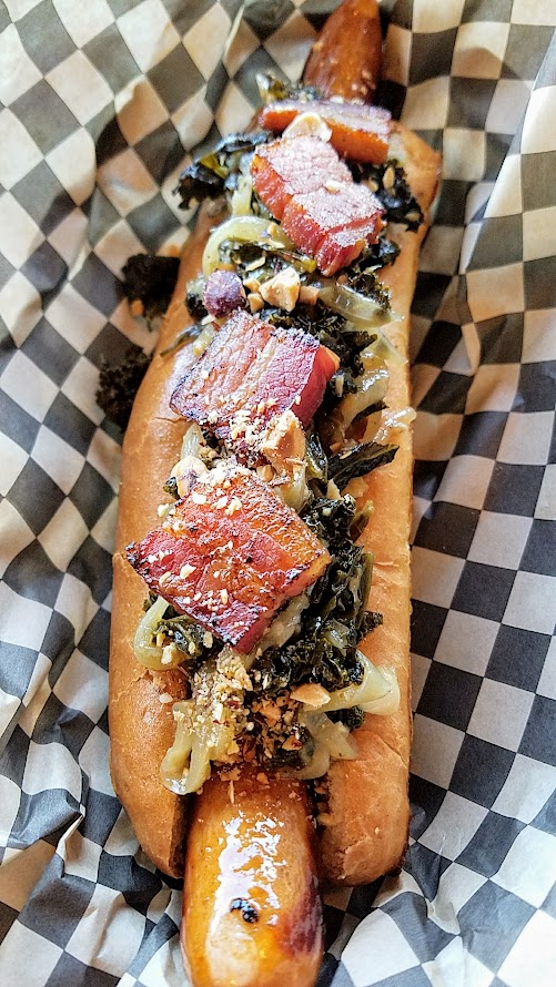 OP Wurst on SE Division, The Portland Dog with pork frankfurter, braised kale, pork belly, hazelnuts
