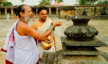 Photo: Priests perfroming the morning rituals in the courtyard of the ancient chennakeshava temple in Balur, Karnataka, India