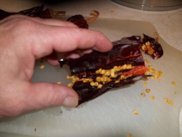 Cut chilies into chucks and place in sauce pan with water just above the...