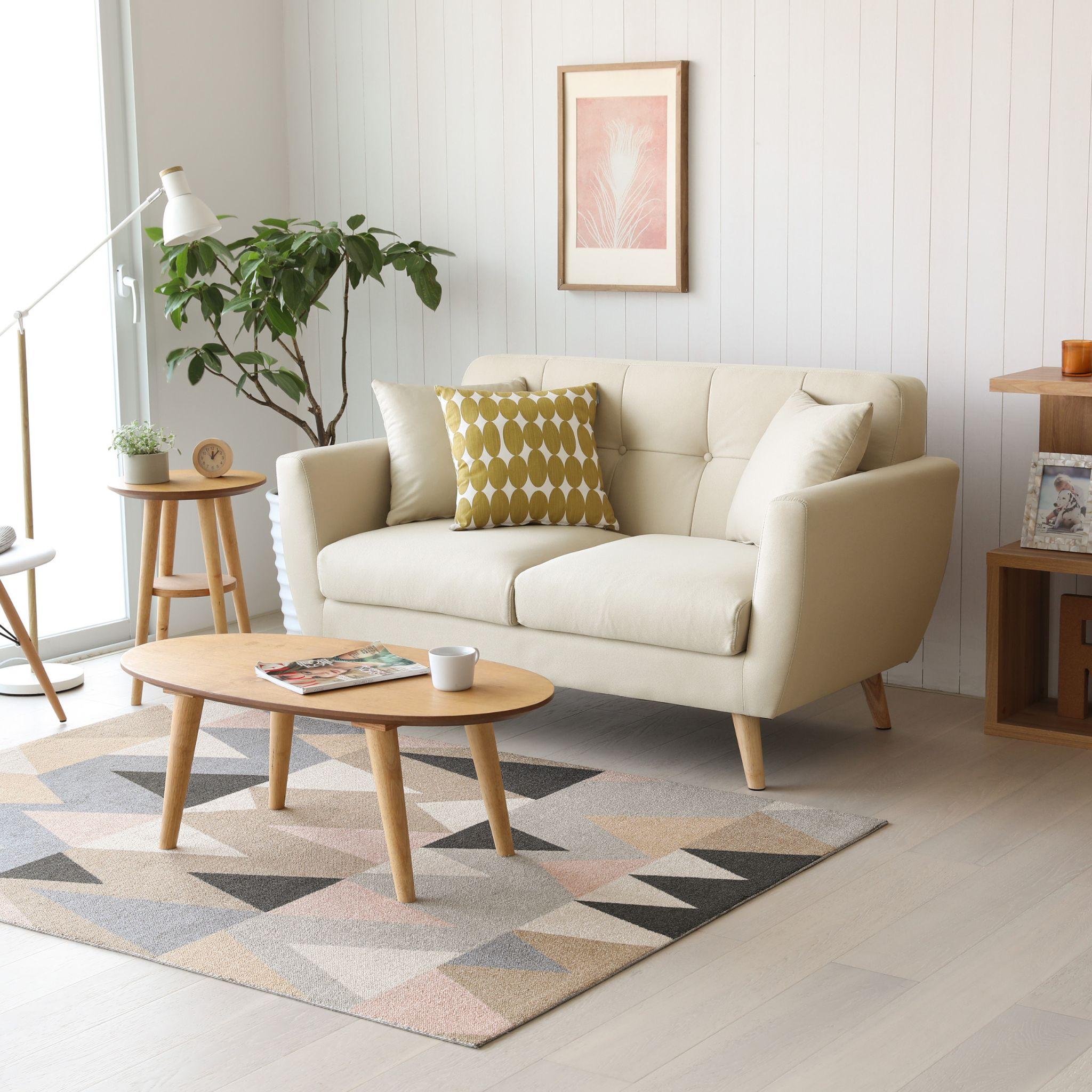 Sofa Mäs decorado de manera Lagom.