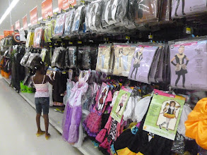 Photo: She's deciding which princess outfit to choose.