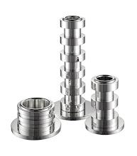 "Photo: PUIFORCAT Sterling silver ""Ruban"" candlestick collection. 1.5"" high, 3"" diameter. $280. 6"" high, 3"" diameter. $650. 3"" high, 2.25"" diameter. $465. France. Seventh Floor. 212 872 2686"