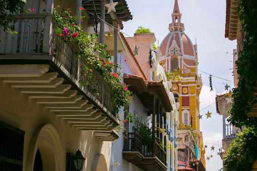 cartagena-alley-view.jpg - Flowers bloom on terraces in Old Cartagena, Colombia.