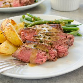 Seared Steaks and Green Peppercorn Sauce with Roasted Potatoes and Green Beans.