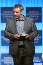 Photo: DAVOS/SWITZERLAND, 25JAN12 -  Luc Besson, Filmmaker, Screenwriter and Producer; Founder, EuropaCorp, France the Annual Meeting 2012 Walks off the stage with the Crystal Award at the Annual Meeting 2012 of the World Economic Forum at the congress centre in Davos, Switzerland, January 25, 2012.  Copyright by World Economic Forum swiss-image.ch/Photo by Sebastian Derungs