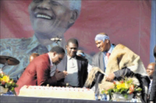 ICON CELEBRATED: Deputy President Kgalema Motlanthe, Deputy Minister of Arts and Culture Paul Mashatile and Chief Zwelivelile Mandela during Nelson Mandela's 91st birthday celebrations in Newtown, Johannesburg, on Saturday. PIC: VATHISWA RUSELO. 19/02/2009. © Sowetan.