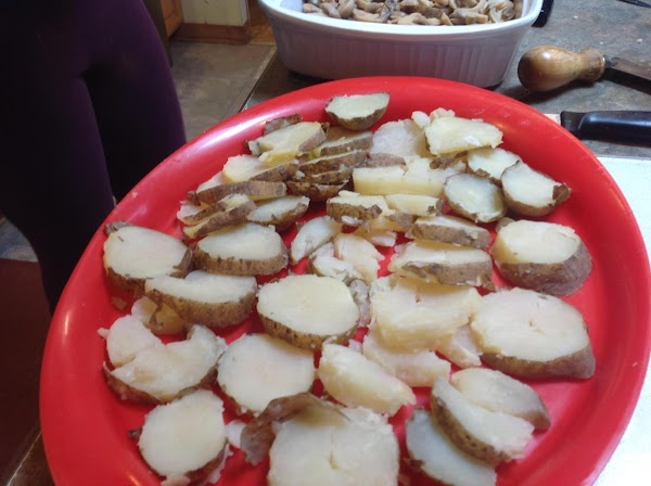 Now layer the remaining potatoes over the cheese, and cover with remaining sauce. Sprinkle...