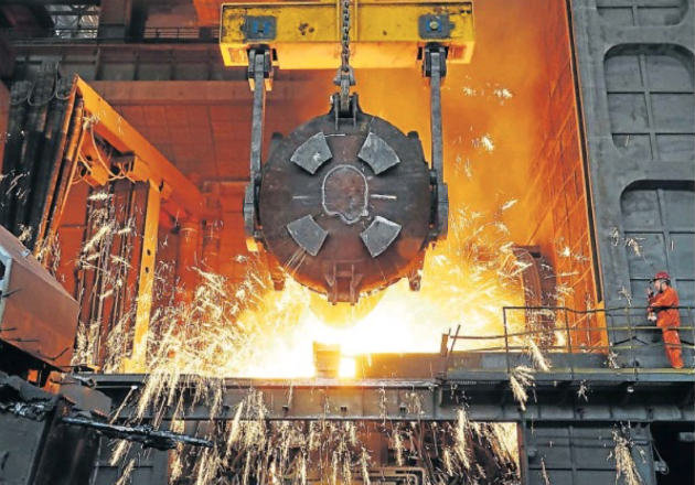 A worker oversees production at a furnace at the steel plant of Dalian Special Steel Co in Dalian, Liaoning province in China
