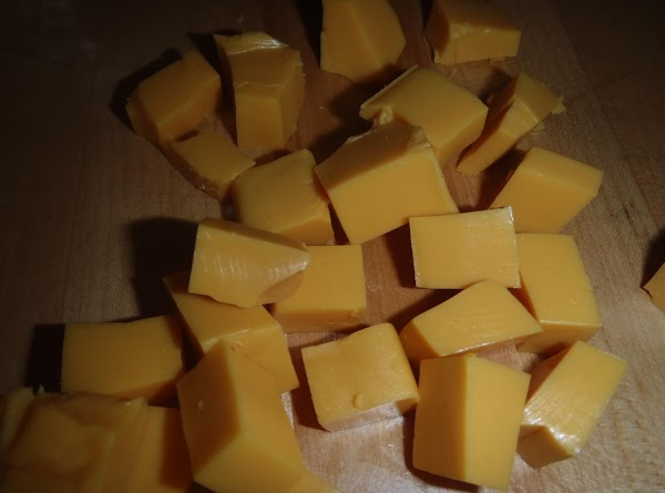 Cut up Velveeta cheese into small bite size cubes and put in a microwave...