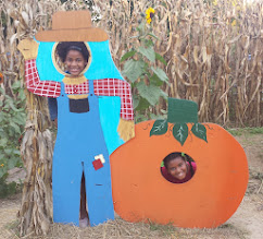 Photo: a farmer and a pumpkin