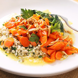 Orange-Glazed Carrots With Ramp Barley and Spinach.