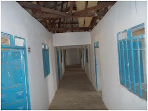 Photo: The hallway inside the Wunlang Clinic. Exam, office, and storage rooms are through the doors on each side of the hallway.
