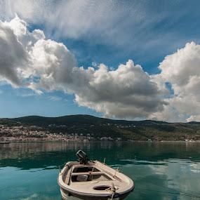 by Grigoris Koulouriotis - Transportation Boats ( clouds, sky, blue, greece, reflections, sea, boat,  )