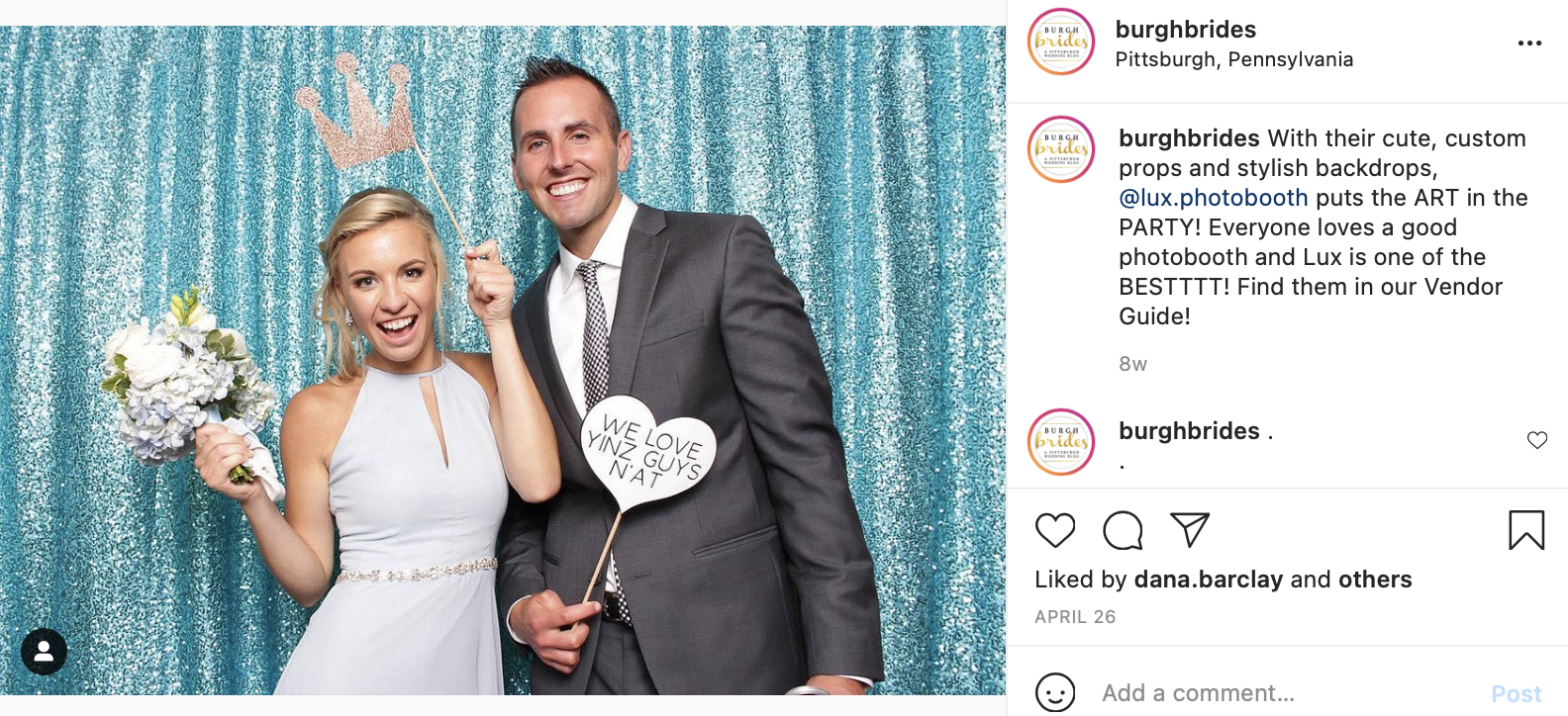 wedding guests pose with props in a photo booth