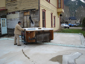 Photo: Winter snow is gone, moving the hot tub into position so we can start walls.