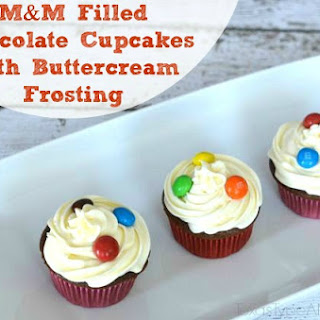 M&M Filled Chocolate Cupcakes with Buttercream Frosting.