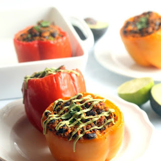 Enchilada-Stuffed Peppers With Avocado Cream.