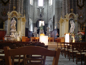 Photo: The main nave and altar, with statues of Saints Peter and Paul.
