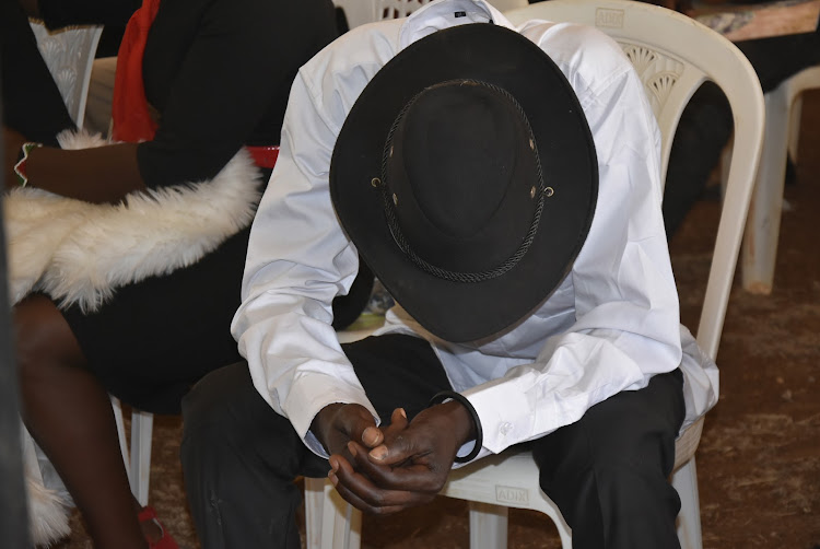 Richard Kihungi, the father of Peter Mbothu who was killed in Kenol chaos t is overwhelmed by emotions during the Requiem Mass in Thika on Friday. the requiem mass held Thika on Friday.