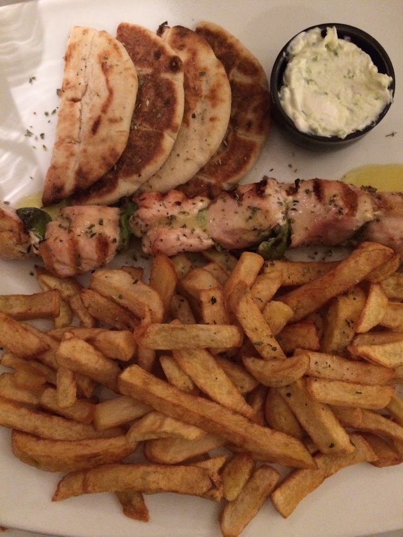 Pita, chicken skewer and fries