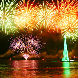 New Year fireworks by Ni Francisco - Public Holidays New Year's Eve ( travel photography, waterscape, fireworks, water, colorful, colors, new year,  )