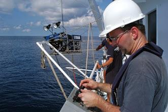 Photo: ROV pilot prepares Hela ROV for launch (Photo credit: P. Auster)