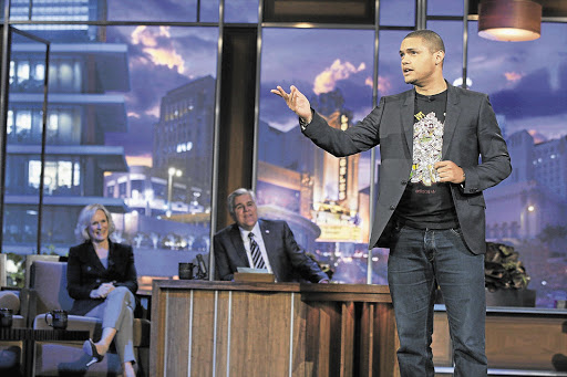 Johannesburg comedian Trevor Noah on The Tonight Show on Friday night, watched by actress Glenn Close and host Jay Leno.