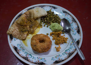 Photo: Clockwise  Medu Vada(Donut Shape), Thosai, Mung Beans and Sambar Northern Sri Lanka