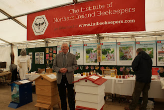 Photo: Tom Canning and the Institute of Northern Ireland Beekeepers stand.