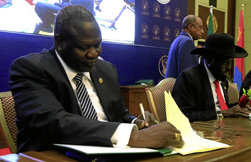 South Sudanese rebel leader Riek Machar, left, and South Sudan's president, Salva Kiir, sign a ceasefire and power sharing agreement in Khartoum, Sudan, on August 5 2018. Picture: REUTERS/MOHAMED NURELDIN ABDALLAH