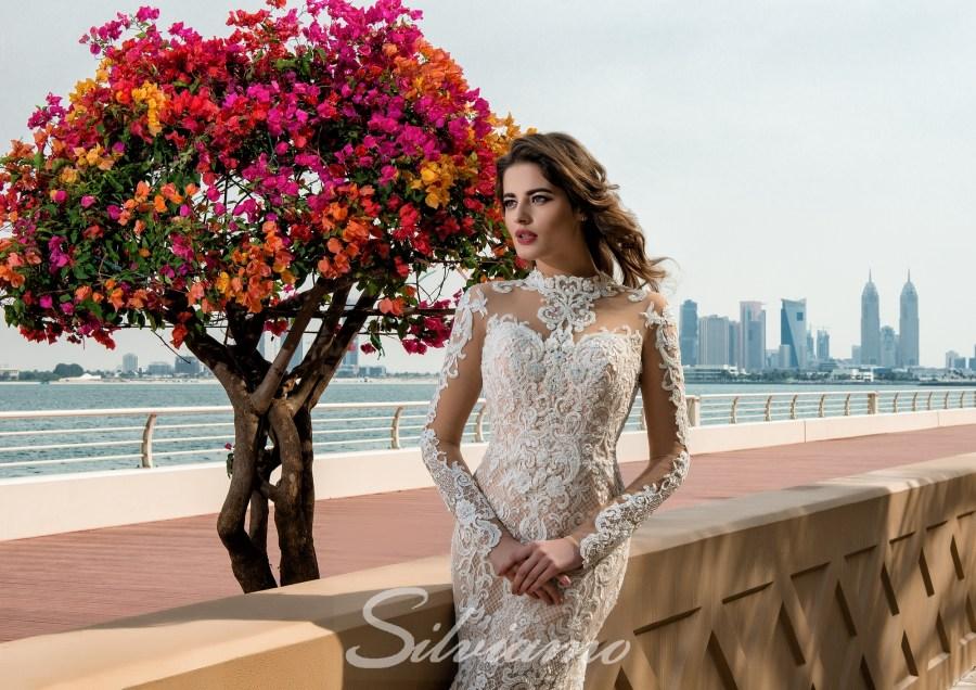 Мереживна весільна сукня з рукавами