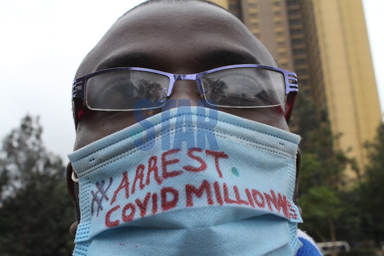 A protester takes part in a demonstration calling for arrest of coronavirus pandemic funds looters at Uhuru Park, Nairobi on August 21, 2020/ANDREW KASUKU